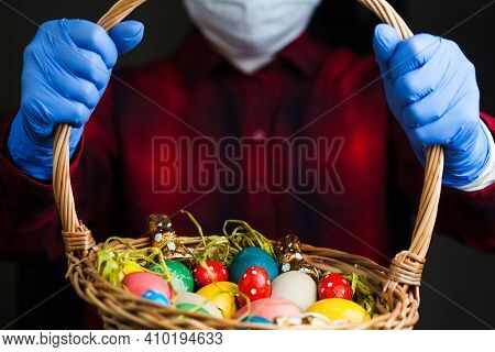 Person Holding Easter Basket Wearing Blue Protective Gloves And Face Mask, 2021 Holiday Celebration