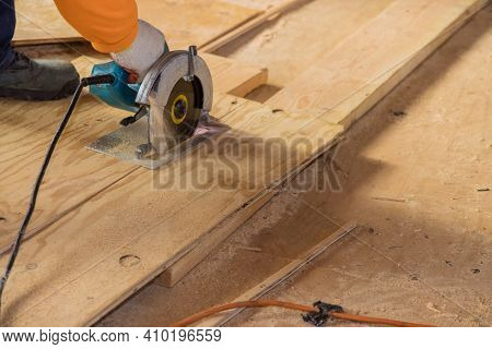 Close Up Process Cutting Of Hand Circular Saw At Wood Plywood Cuts On A House Renovation.