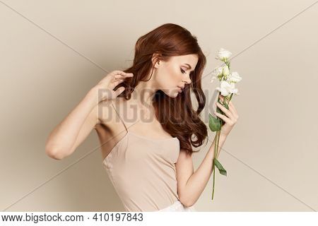 Happy Woman With A Bouquet Of Light Flowers On A Beige Background Naked Shoulders Model Red Hair Bea