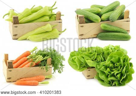 Fresh cooking vegetables in a wooden crate on a white background