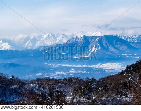 The Snow-covered Peaks Of The Japanese Alps As Viewed From Near The Summit Of The Shiga Kogen Ski Ar