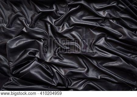 Luxurious Black Silk Satin Cloth Flat Lay Background. Black Abstract Smoot Rippled Fabric Stylish To