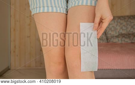 Leg Waxing. Young Woman Waxing Legs Close Up. Hair Removal With Wax At Home