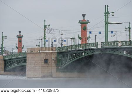 Saint Petersburg, Russia - February 15, 2021: Palace Bridge And Rostral Columns On A Frosty February