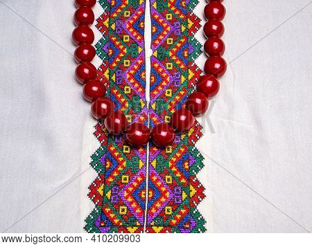 Red Womens Beads On Ukrainian Embroidered Shirt. The Necklace Is Female. Ukrainian National Clothes.
