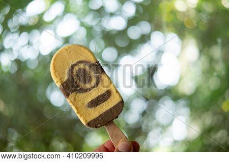 Bangkok, Thailand - February 28, 2021 : A Male Hand Holding Paddle Pop Minions Caramel And Chocolate