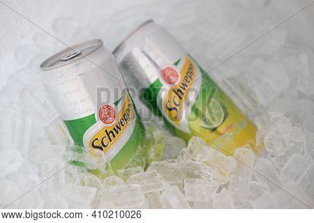 Bangkok, Thailand - February 28, 2021 : Two Can Aluminium Schweppes Manao Soda On Ice Basket, Popula