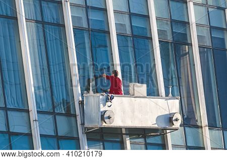 Window Washer Cleaning The Glass Facade Of A Office Building. Unrecognizable Person