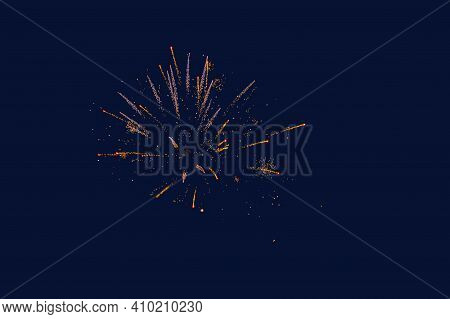 Fireworks lights golden,  yellow,  white  colors in night sky isolated on blue background. Photo with blur in motion