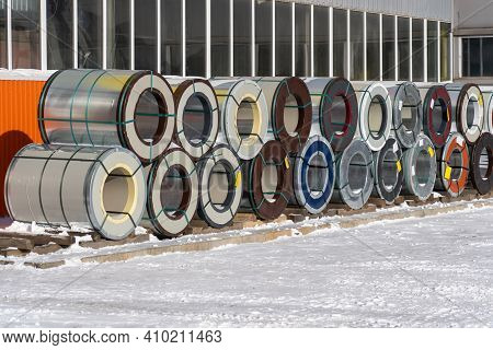 Rolls Of Sheet Metal Are Stored On A Skuld In The Open Air In Winter