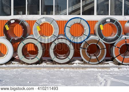 Pallets With Rolls Of Sheet Metal In The Open Air In Winter