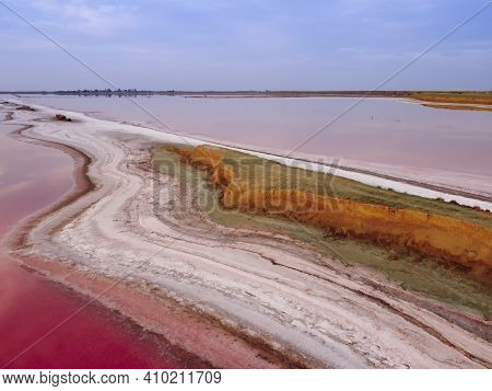 Top View Of A Pink Lake. The Narrow Shore Separating The Lake And The Sea Bay. Pink Lake With High S