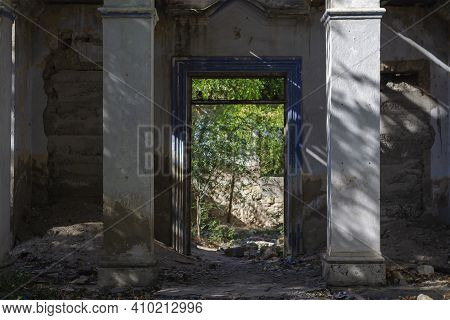 Old Abandoned House, Without Door Entry. Entrance In The Abandoned Old Brick House Without The Door.