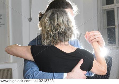 A Tango Couple Dancing Tango In An Indoor Rehearsal Room
