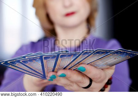 Fortune Telling, Woman With Tarot Cards In Hands Close Up. Concept Of Seeing The Destiny, Divination