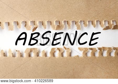 Absence. Text On White Paper Over Torn Paper Background.