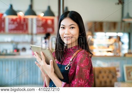 Beautiful Entrepreneur Asian Woman With Long Hairstyle Holding Digital Tablet