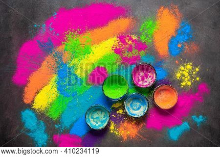 Colored Holi Powders Background. The Bowls Are Empty Of Holi Paints. Holi Traditional Festival. Top