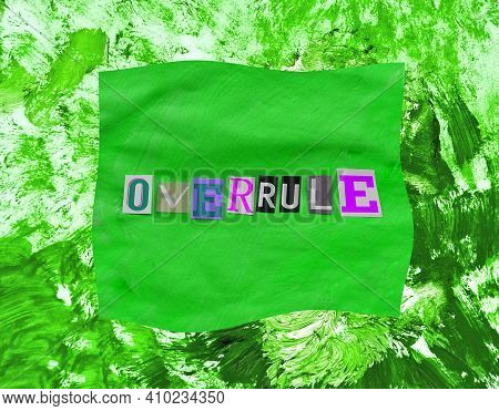 Overrule Word From Paper Magazins Letters On Green Distorted Frame And Chaotic Paint Strokes. Grunge