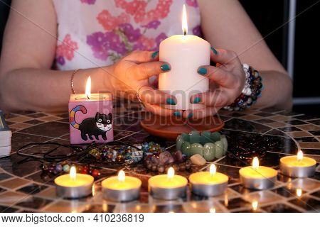 Fortune Telling Session, Seeing The Destiny And Astrology. Female Hands With Candles On The Round Ta