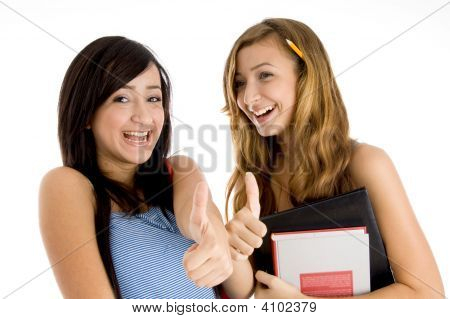 Students Showing You Thumb Gesture With Bag And Books