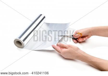 Lifehack, female hand cutting aluminum foil to sharpen scissors isolated on white background