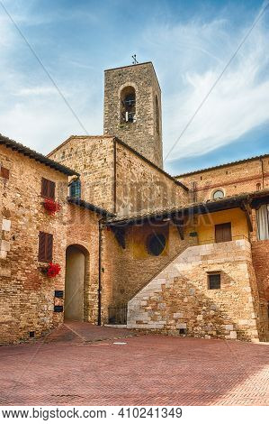 The Medieval Architecture Of San Gimignano, Iconic Town In The Province Of Siena, And One Of The Mos