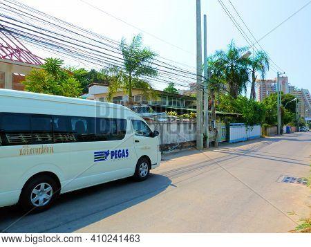 Bus, Minivan Of The  Travel Company On The Street In Pattaya -  Pattaya, Thailand - 02/18/2011