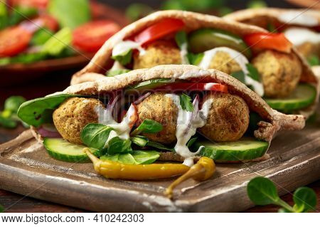 Vegetarian Chickpea Falafel Pita Bread With Pickled Chilies And Fresh Salad. Healthy Vegan Food.
