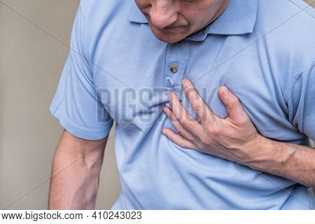 Heart Pain, A Person Grabbing The Heart Area With His Hand, Suffering From Chest Pain, Having A Hear