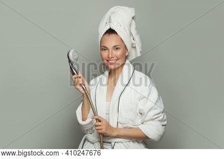 Spa Model Woman In White Bathrobe Holding Shower On Gray Background