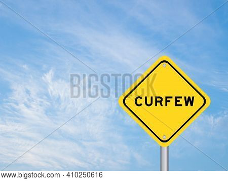 Yellow Color Transportation Sign With Word Curfew On Blue Sky Background