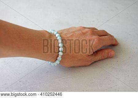 Larimar Bracelet. A Bracelet Made Of Stones On A Hand From A Natural Stone Larimar. Bracelet Made Of