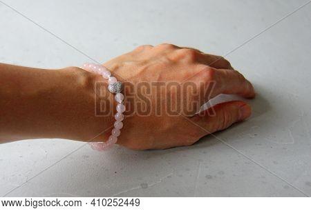 Rose Quartz Bracelet Heart. A Bracelet Made Of Stones On A Hand From A Natural Stone Rose Quartz. Br