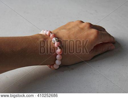 Pink Opal Bracelet. A Bracelet Made Of Stones On A Hand From Natural Stone Pink Opal. Bracelet Made