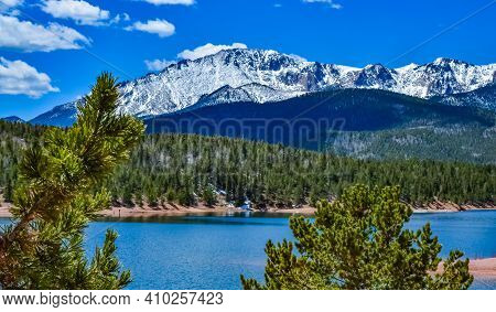 Panorama Snow-capped And Forested Mountains Near A Mountain Lake, Pikes Peak Mountains In Colorado S