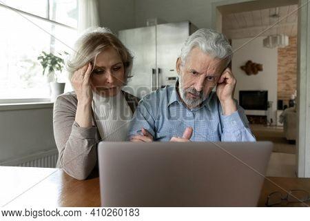 Upset Senior Couple Getting Shocking Bad News