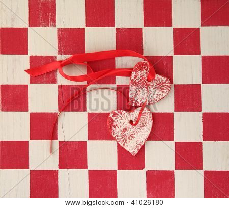 checkerboard with two hearts