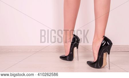 Woman Legs In Black Fetish Shiny Patent Leather Stiletto High Heels With Ankle Strap