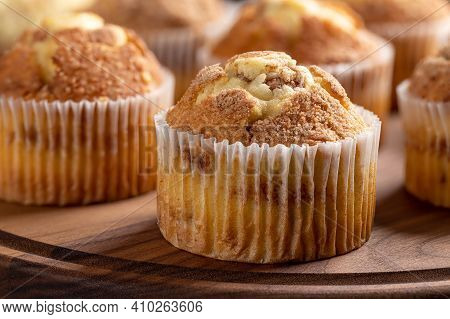 Closeup Of A Bunch Of Cinnamon Muffins On A Rustic Wooden Platter