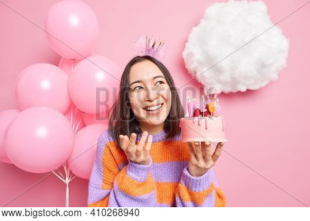 Indoor Shot Og Happy Pleasant Looking Woman Smiles Broadly Holds Tasty Cake With Burning Number Cand
