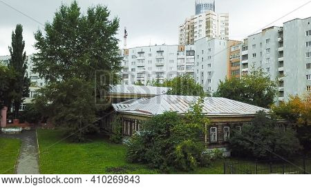 Old Rustic House In City Center. Stock Footage. Old Wooden House Is Located In Center Of City On Bac