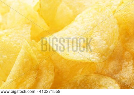 Potato Chips Pattern. Yellow Salted Potato Chips As Food Background. Chips Texture, Studio Photo, Cl