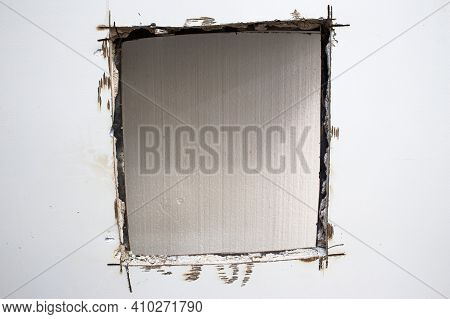 A Sawed Hole In A Bank Safe. Sentry Safe Cut Hole. Explosion-proof Steel Walls Of The Safe Filled Wi