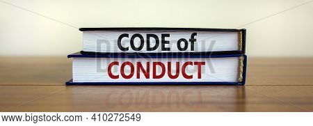 Code Of Conduct Symbol. Concept Words 'code Of Conduct' On Books On A Beautiful Wooden Table, White