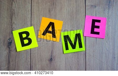 Bame Symbol. Abbreviation Bame, Black, Asian And Minority Ethnic On Colored Papers. Beautiful Wooden