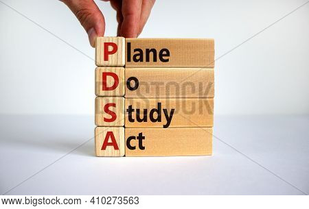 Pdsa, Plan Do Study Act Symbol. Businessman Hand. Wooden Cubes And Blocks With Words 'pdsa, Plan Do