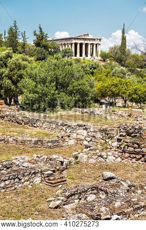 Ancient Greek Ruins In Agora, Athens, Greece. Temple Of Hephaestus, Landmark Of Athens In Distance.