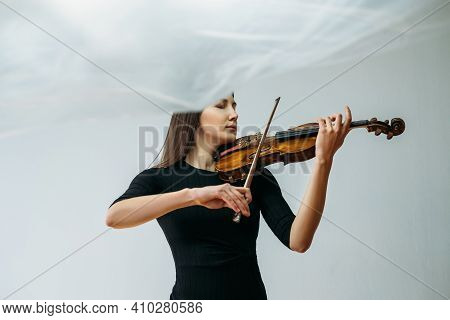 Inspired Violinist Woman. Online Concert. Self Isolation. Professional Artist. Calm Lady Playing Vio