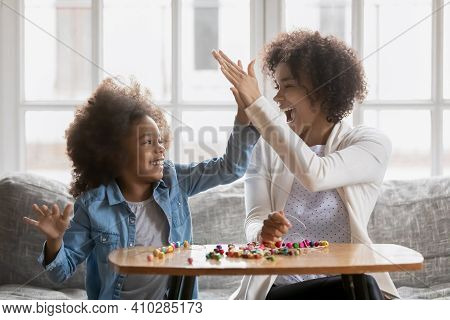 Proud Mom Giving High Five To Daughter